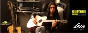 Gus G avec sa Lâg Tramontane Custom Bédarieux dans Guitare Sèche le Mag